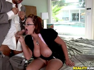 Busty MILF round glasses sucks plus fucks two broad in the beam dicks